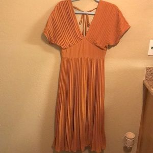 I am selling a mustard yellow altar'd state dress.